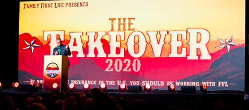 Shawn Meaike speaking at podium in front of Takeover 2020 banner